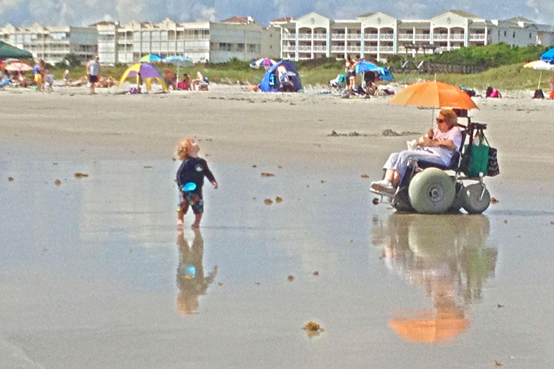 Boy on the beach by Michelle Bazis